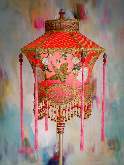 1920s antique floor lamp with scrolls has been hand painted and holds a hand-dyed exotic Chinoiserie Red Lantern with Cranes silk lampshade.