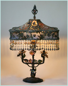 Antique tole  lamp with lace shade