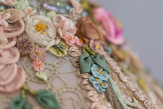 close up of antique silk ribbon work flowers